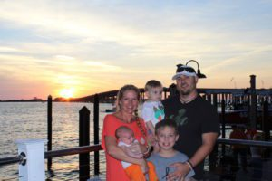 kristen webb and family at sunset on destin harbor