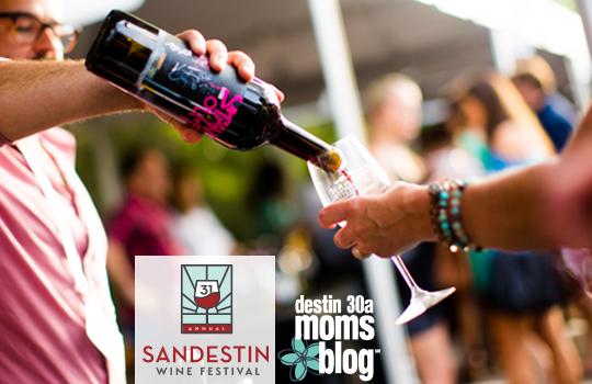 hand pouring wine sandestin wine festival