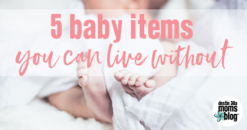 baby feet in white blanket baby items you don't need