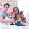 Family portrait with dogs on the bed