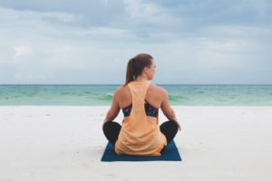 yoga saved me _ mediating on the beach